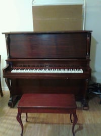 brown wooden upright piano with chair Montréal, H1E 1J6