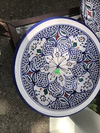 Round blue, white, and green ceramic plate