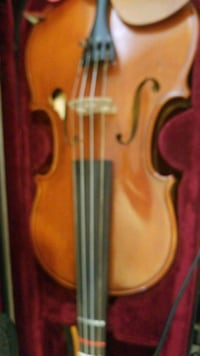 brown wooden violin with bow accent St. Louis, 63113