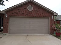 Garage door with rails and motor and an inside remote.