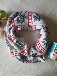 white, black, and red knit scarf