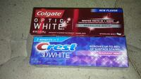two Colgate and Crest toothpaste boxes