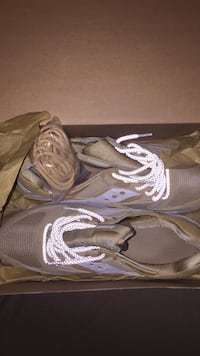 pair of brown Saucony low-top sneakers with box