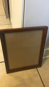 brown wooden painting frame