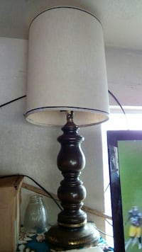 black wooden base with white lampshade table lamp