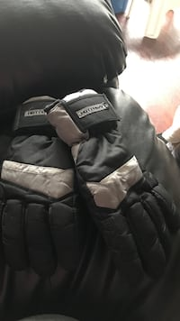 pair of white and black Hot Paws gloves Langley, V3A 1Z2