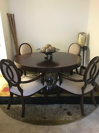 Dining room table round wood expresso with metal pedestal and 6 chairs