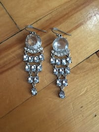 pair of women's silver-colored dangling earrings with clear gemstones