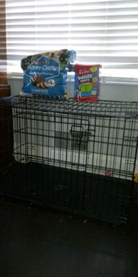 Large dog cage with more than half bag of food!