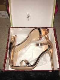 (worn once) gold heels, size 10 women's (obviously LOL) Carrollton, 75007