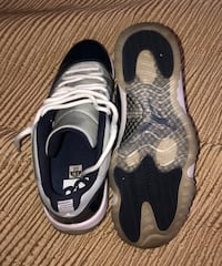 Pair of gray-and-navy blue nike sneakers Biloxi, 39530