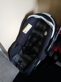baby's blue and white car seat carrier