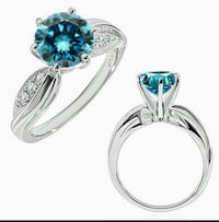 two silver and sapphire embellished rings