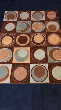 Brown, white, and blue area rug (63x48) and frames West Mifflin, 15122