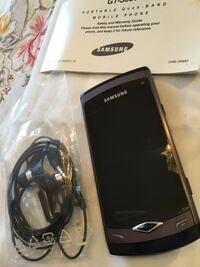 Samsung. Wave phone  unlocked. This phone is new it has full instruction manual still in box Red Deer, T4P 3X1