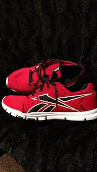pair of red-and-white Nike running shoes Saint Charles, 63303