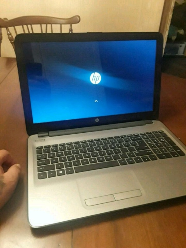 gray and black HP laptop