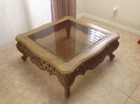 rectangular brown wooden framed glass top coffee table North Port, 34286