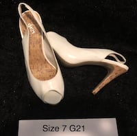 pair of women's white leather pumps Surrey, V3R 8C6
