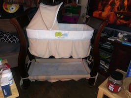 Sled  baby bed solid cheri wood says just one year