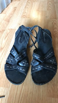 pair of black leather open-toe sandals 580 km