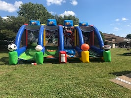Inflatables, tents, tables, and chairs for sale.