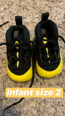 Infant black and yellow Nike foamposite