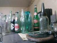 green and clear glass bottles Quapaw, 74363