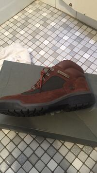 unpaired brown Timberland boots with box