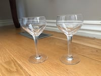 two clear glass footed bowls