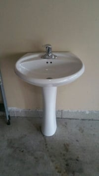 white ceramic pedestal sink with stainless steel faucet Toronto, M1S 3B1