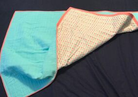 Teal and coral double gauze blanket