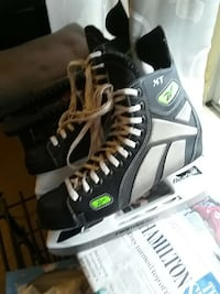 pair of white-and-black Reebok XT ice skates Hamilton, L8M 3A4