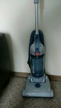 gray and black Bissell upright vacuum cleaner