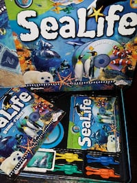 1995 *SEALIFE* DVD Board Game in Collectors Tin  2 DISCS LIKE NEW...ALL PARTS...GREAT PRICE!  Pick up in Edmonton, near the Kingsway area. NO holds NO delivery 3154 km