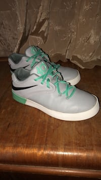 pair of white-and-green Nike basketball shoes Des Moines, 50315