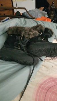 pair of black leather winter boots New York