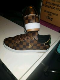 unpaired brown and black Coach monogram high top sneaker Granville, 2142
