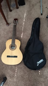 Brown classical guitar with case 22 km