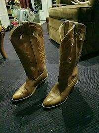 pair of brown leather cowboy boots 2237 mi