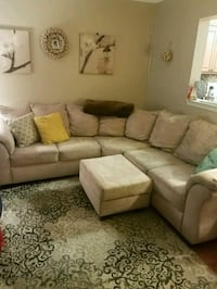 Cream sectional sofa and ottoman Bryans Road