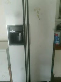 white side-by-side refrigerator with dispenser Spring Hill
