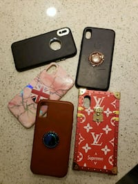 three black, brown, and red iPhone cases Houston, 77027