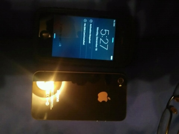 black iPhone 4 with case 2 0f them