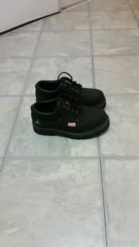pair of black low top sneakers Mississauga, L4Z 3E9