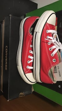 pair of red Converse All-Star low-top sneakers with black box