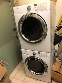 White front-load clothes washer and dryer set 557 km