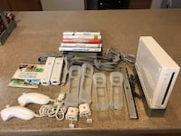 white Nintendo Wii console with controllers and game cases Springfield, 22150