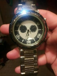 round silver-colored chronograph watch with link bracelet 161 mi