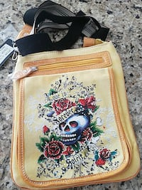 beige and black skull print messenger bag